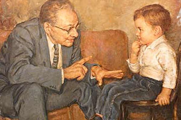 homem falando com criança sentada em cadeira
